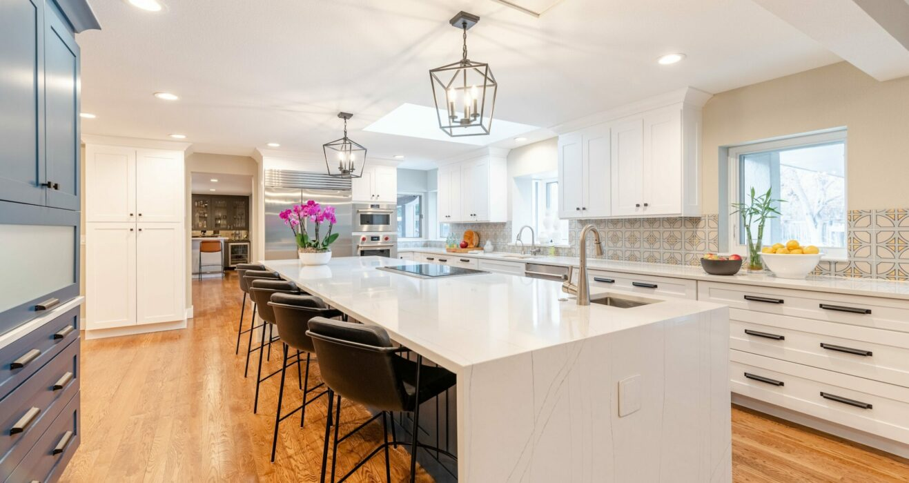 Kitchen with large white marble island