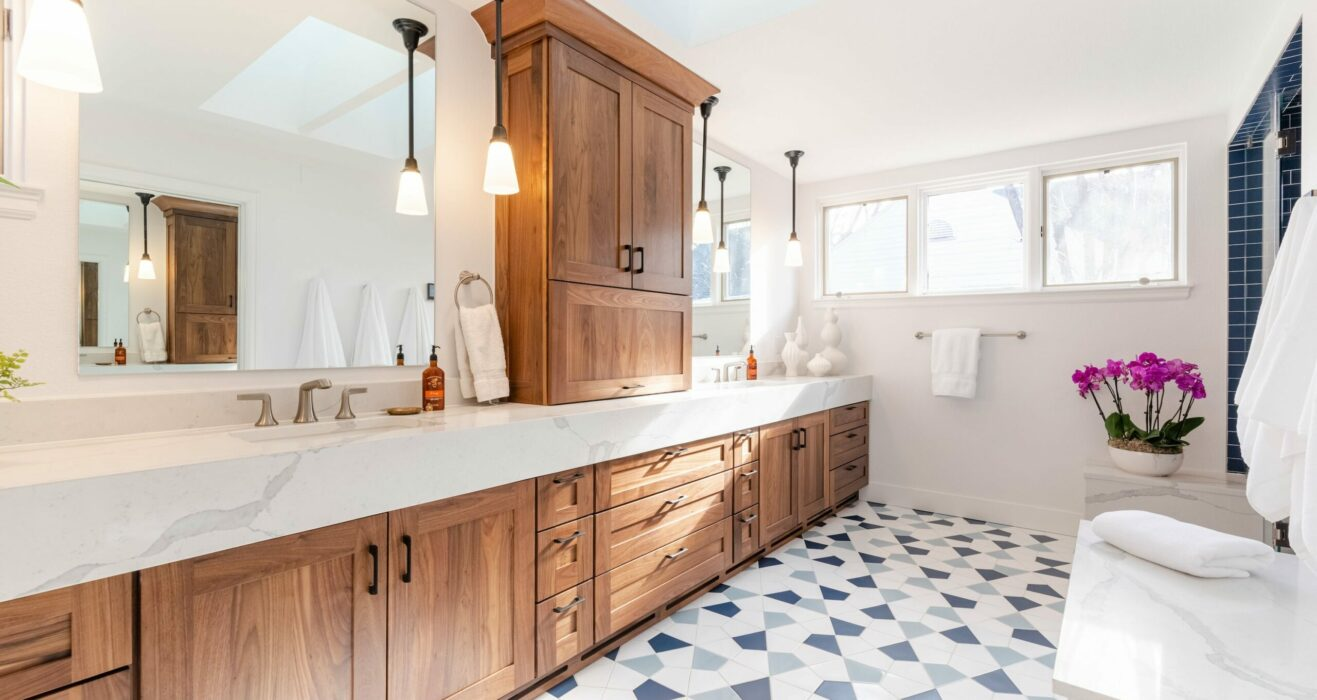Bathroom remodel with rich wooden cabinets and white countertop