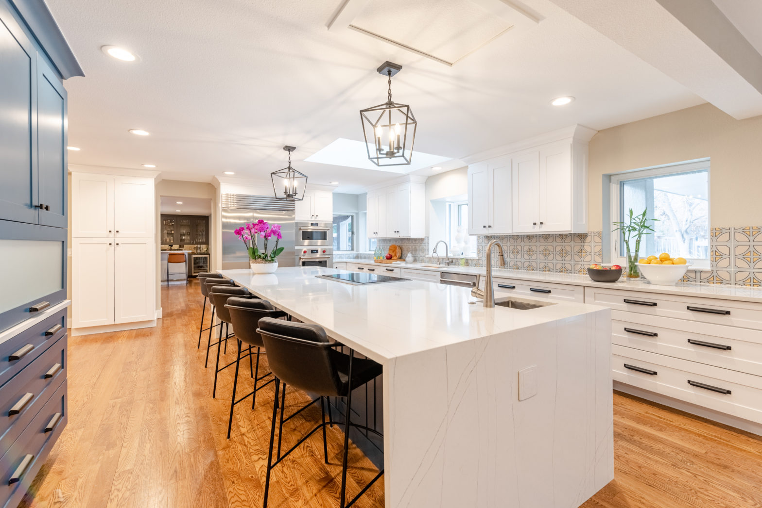 open-space kitchen with white counter tops and blue cabinets